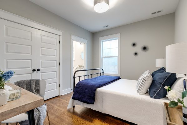 Guest bedroom in home by Richmond Hill Design-Build