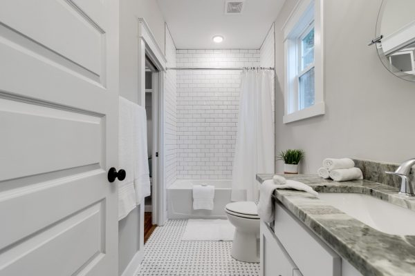 Guest bathroom with subway tile shower in home by Richmond Hill Design-Build