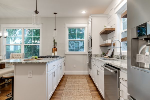 Beautiful, updated kitchen with white cabinetry and countertops