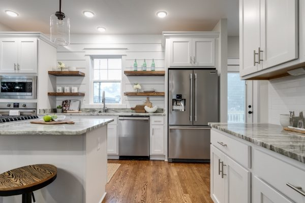 Gorgeous kitchen with floating shelves in home built by Richmond Hill Design-Build
