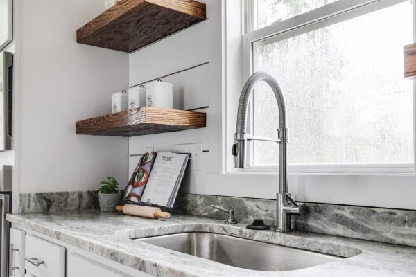 Kitchen with floating shelves in home built by Richmond Hill Design-Build