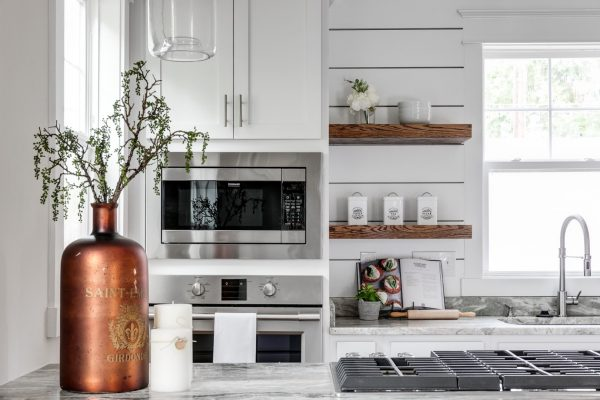 Beautiful, updated kitchen with white cabinetry and floating shelves built by Richmond Hill Design-Build