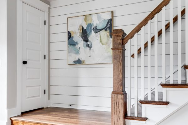 Entryway with shiplap in new home built by Richmond Hill Design-Build