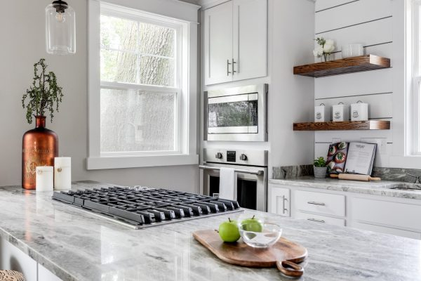 Beautiful, updated kitchen with white cabinetry and countertops built by Richmond Hill Design-Build