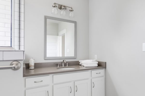 White vanity in bathroom in renovated home by Richmond Hill Design-Build