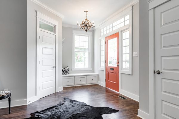 Beautiful foyer with bench seat and ample windows