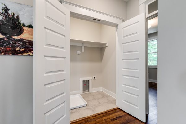 Laundry room in home built by Richmond Hill Design-Build