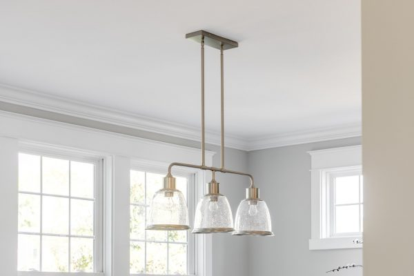 Pendant chandelier in dining room in home built by Richmond Hill Design-Build