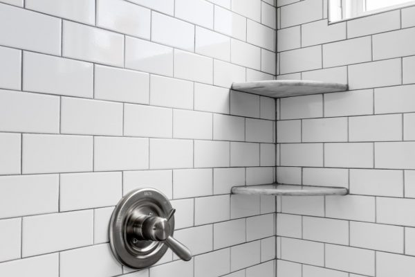 Subway tile in owner's shower by Richmond Hill Design-Build
