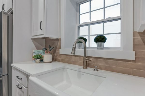 Porcelain farmhouse sink and subway tile backsplash in beautiful home by Richmond Hill Design-Build