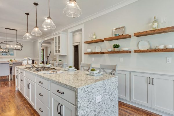Island and floating wood shelving in beautiful kitchen by Richmond Hill Design-Build