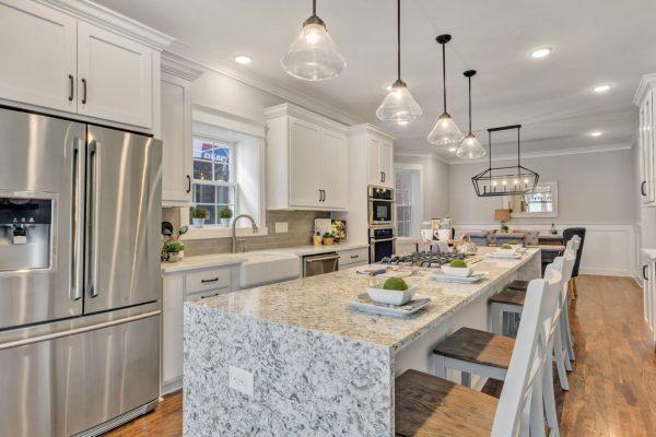 Waterfall granite Island in beautiful kitchen by Richmond Hill Design-Build