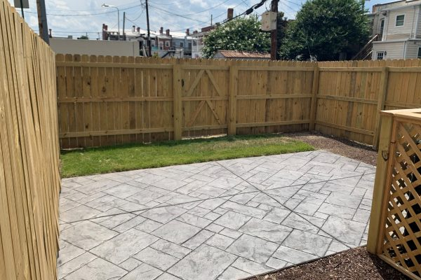Rear fenced yard and patio of townhome by Richmond Hill Design-Build