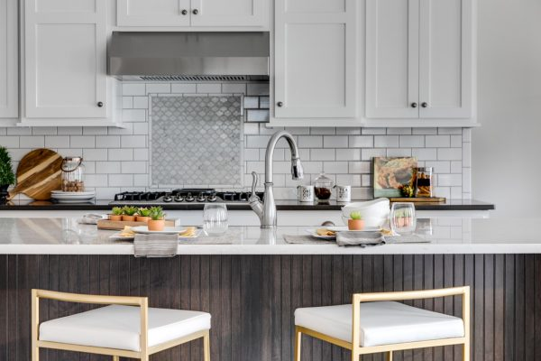 Kitchen with subway tile backsplash in new home built by Richmond Hill Design-Build