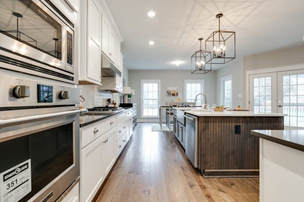 Kitchen with wood floors in new home built by Richmond Hill Design-Build