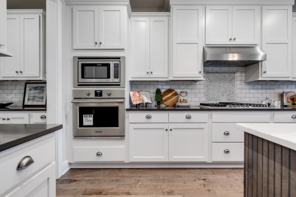 Kitchen with white cabinetry in new home built by Richmond Hill Design-Build