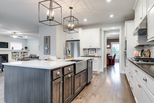 Kitchen with island and pendant lights in new home built by Richmond Hill Design-Build