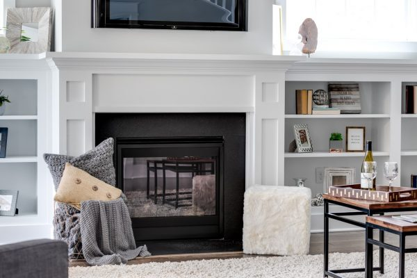 Family room with fireplace in new home built by Richmond Hill Design-Build