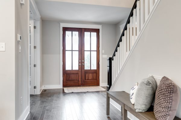 Entryway with double wood doors in new home built by Richmond Hill Design-Build
