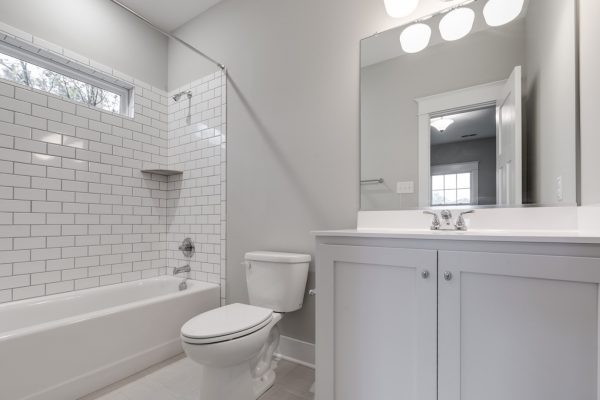 Beautiful guest bathroom in new home by Richmond Hill Design-Build