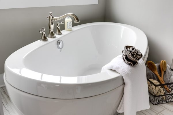 Freestanding tub in bathroom in new home by Richmond Hill Design-Build