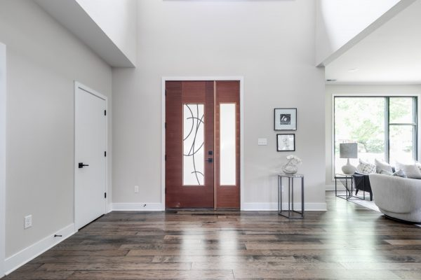 Beautiful double front doors in new contemporary home by Richmond Hill Design-Build