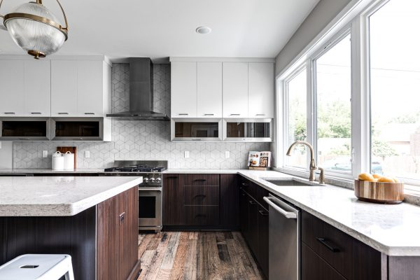 Stunning kitchen with white cabinetry in new contemporary home by Richmond Hill Design-Build