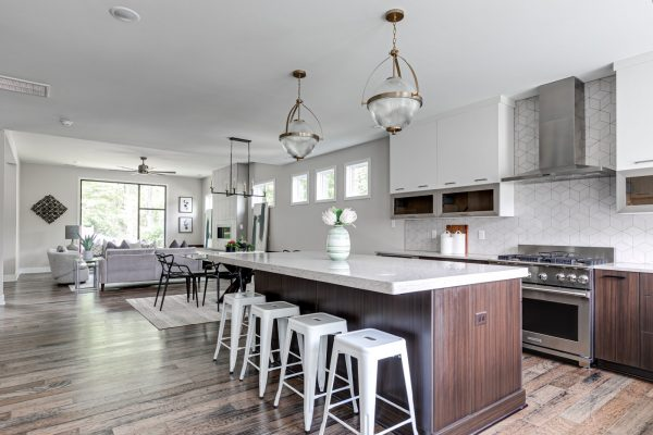 Stunning kitchen with pendant lighting and island in new contemporary home by Richmond Hill Design-Build