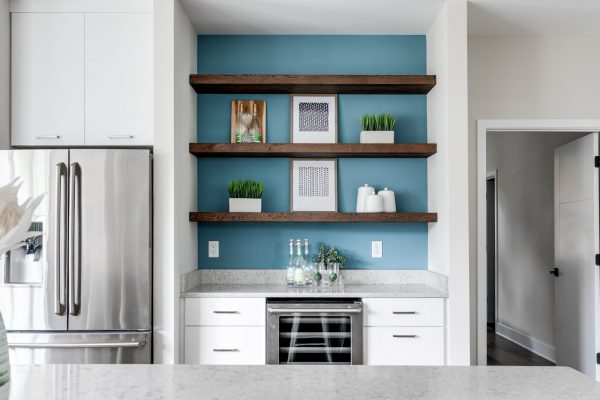 Gorgeous kitchen with floating shelves and wine fridge in new contemporary home by Richmond Hill Design-Build