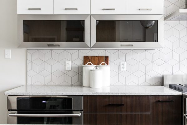 Gorgeous kitchen with white and dark brown cabinetry in new contemporary home by Richmond Hill Design-Build