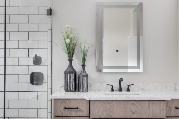 Gorgeous owner's bathroom in new contemporary home by Richmond Hill Design-Build