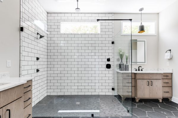 Gorgeous owner's bathroom with oversized shower in new contemporary home by Richmond Hill Design-Build