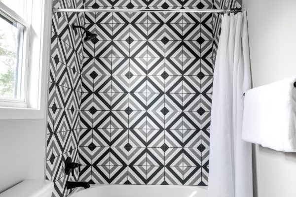 Tile shower wall in new contemporary home by Richmond Hill Design-Build