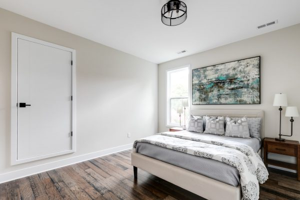 Guest bedroom in new contemporary home by Richmond Hill Design-Build