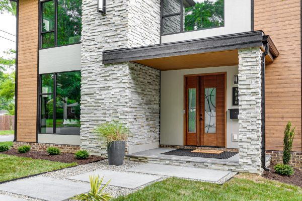 Stunning front entryway of new contemporary home by Richmond Hill Design-Build