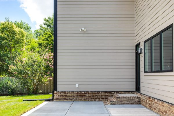 Rear patio of new contemporary home by Richmond Hill Design-Build