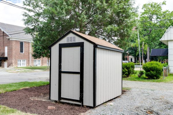 Storage shed in rear yard of new contemporary home by Richmond Hill Design-Build