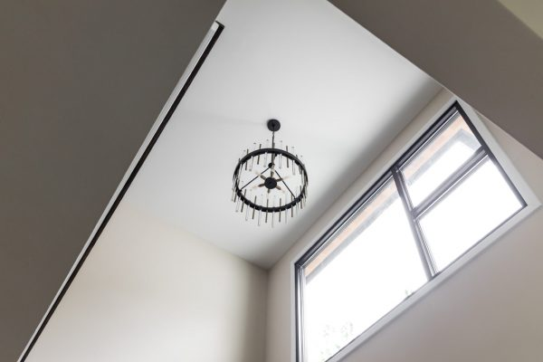 Chandelier in new contemporary home by Richmond Hill Design-Build