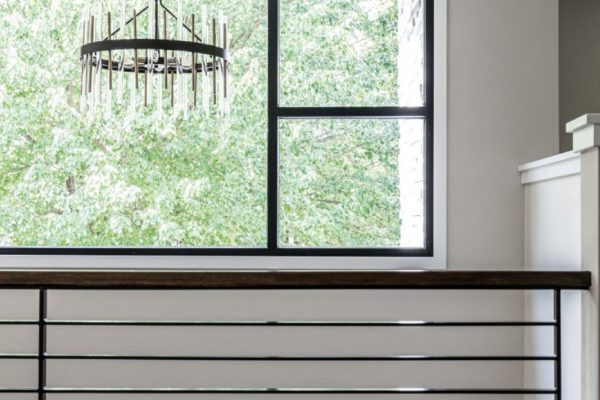 Gorgeous chandelier in foyer of new contemporary home by Richmond Hill Design-Build