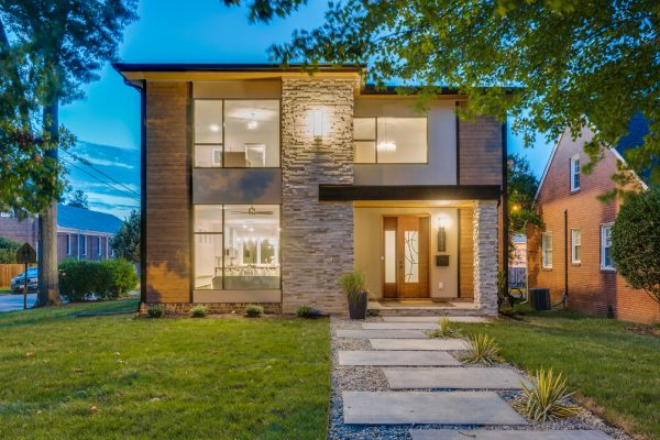 Stunning twilight photo of exterior of new contemporary home by Richmond Hill Design-Build