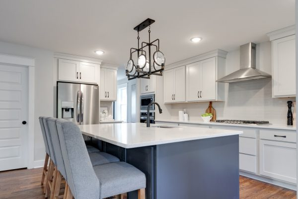 Kitchen island in renovation of Dutch Colonial home by Richmond Hill Design-Build