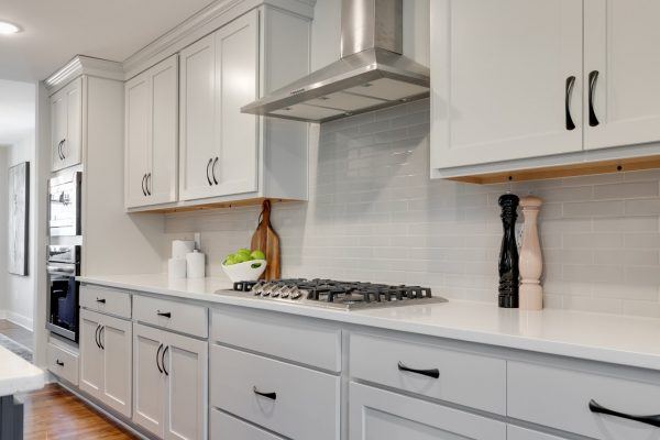 Cooktop and hood in kitchen of renovated home by Richmond Hill Design-Build