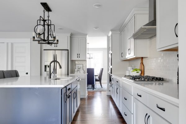 Two-toned cabinetry in kitchen of renovated home by Richmond Hill Design-Build