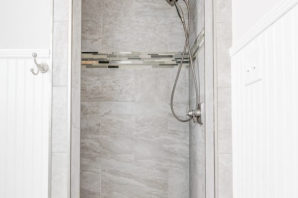 Shower in guest bathroom in renovated Dutch Colonial home by Richmond Hill Design-Build