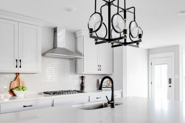 Light fixture over kitchen island in renovation of home by Richmond Hill Design-Build