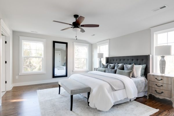 Owner's bedroom in renovated Dutch Colonial home by Richmond Hill Design-Build