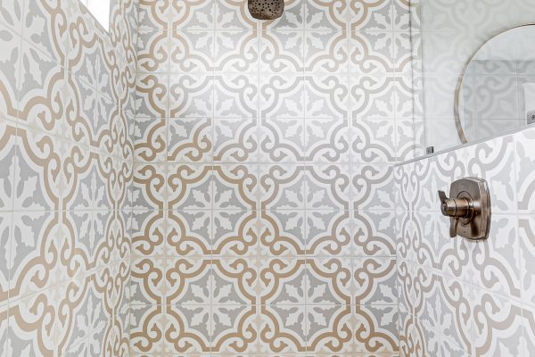 Beautiful tiled shower in owner's bathroom in renovated Dutch Colonial home by Richmond Hill Design-Build