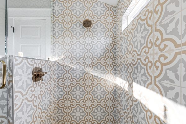 Gorgeous shower in owner's bathroom in renovated Dutch Colonial home by Richmond Hill Design-Build