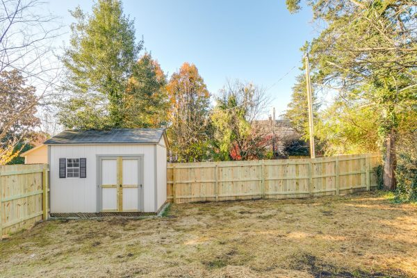 Rear yard with shed and fence of renovated Dutch Colonial home by Richmond Hill Design-Build