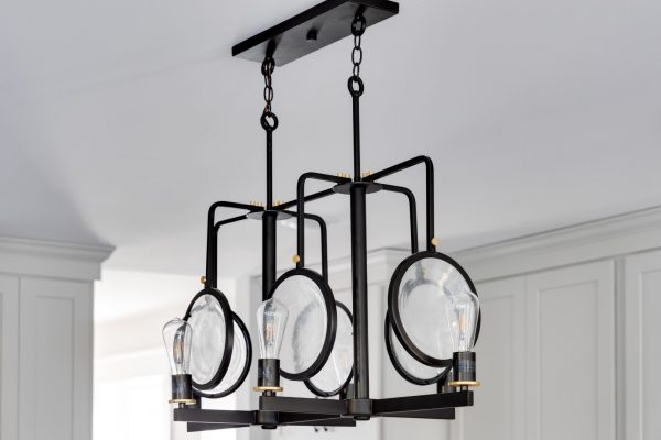Light fixture in kitchen of renovation of home by Richmond Hill Design-Build